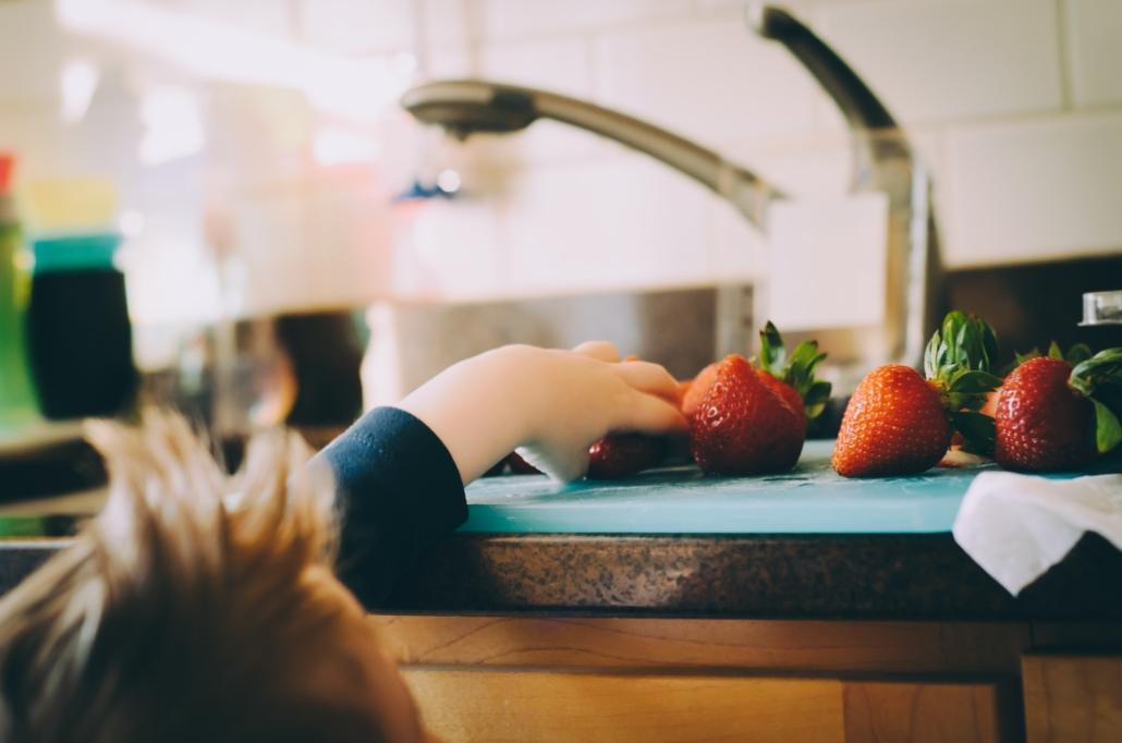 child choosing strawberries
