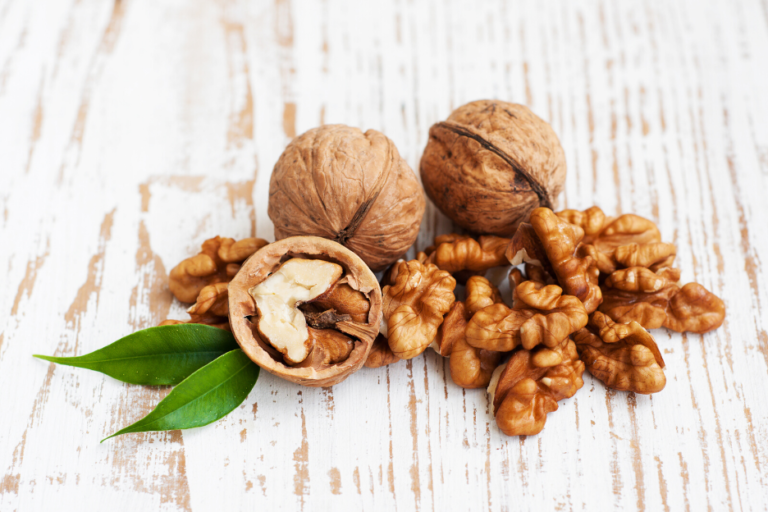 Walnuts and their fatty acids differentially impact the gut microbiota of those at risk of cardiovascular disease